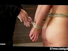 Brunette gets tight bondage of all body in dungeon