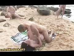 Girl fucking doggystyle on the beach