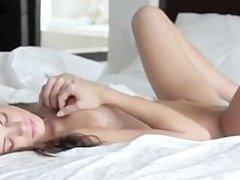 brunette solo masturbation on bedstead
