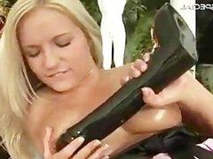 Blond slutty babe working on a huge dildo