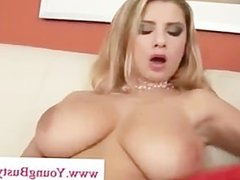 Busty Katy flirts with the camera and fucks herself with her toy
