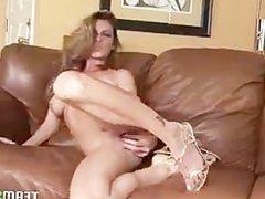 Seductive blondie strips off her lingerie and masturbates
