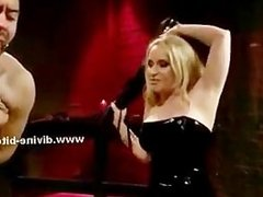 Blonde divine bitch in tight leather dress and with nasty whip sp