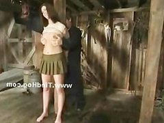 Sexy brunette teen babe undressed and bound from pole in barn get