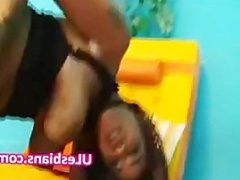 Young petite ebony uses dildo to fuck black gf on her all fours