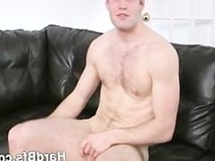 Handsome guy massages his nice dick