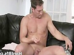 Horny guy oils up his nice cock