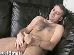 Hot guy massaging his large penis