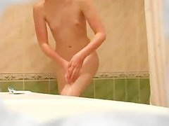 Russian cute teen with tiny tits taking a shower
