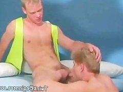 Two horny twinks get down on their knees and suck each other