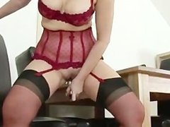 Mature redhead in stockings gets off