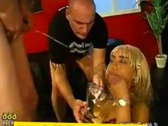 Blonde babe drinks piss and gets pissed on in groupsex