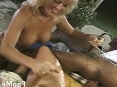 Hot MILF gives head to two horny guys