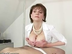 Slave gets his cock titty fucked by domina