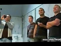 Bound gay dick vibed by group of gays in public rest room
