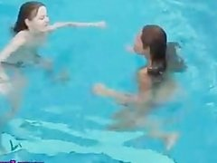 Teens rubs tits in the pool