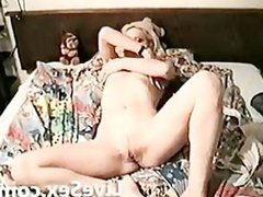 Blondie caressing herself in the bed