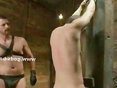 Gay slave has an instant erection when master starts punishing hi