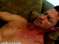 Blonde femdom oils a guy's butt and fucks him