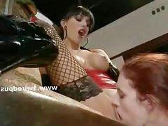 Busty lesbian mistress in stockings
