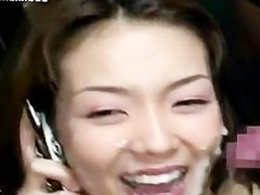 Japanese Slut Talks On Her Phone While Taking Massive Cumshots
