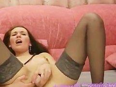 Brunette In Black Stockings Dildos Her Pussy
