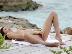 Exotic woman masturbating on the beach