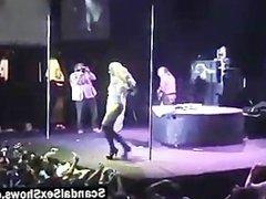 Blonde female stripper abuses a dildo