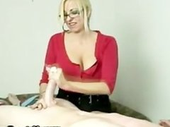 Cheeky MILF enjoys tugging cock
