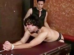 Submissive slave gets spanked by master
