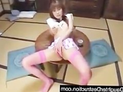Asian girl has fun with some toys and...