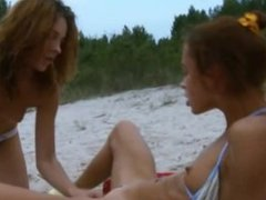 lesbians with ass toy on public beach