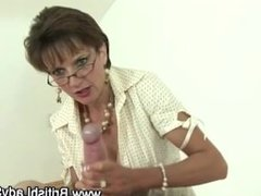 Old slut gives handjob to younger guy