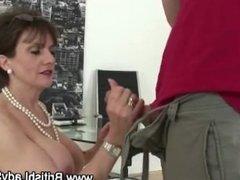 Busty whore sucks dick