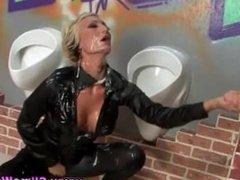 Classy clothed babe sucks cock and gets bukkake in gloryhole