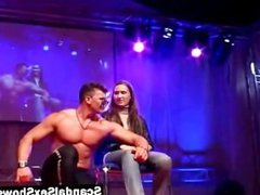 Male stripper gives a show on stage