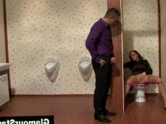Gloryhole loving chick rides toilet cock with some difficulty