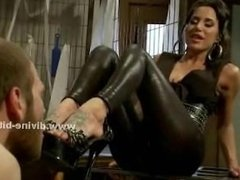 Mistress flogs a man's balls