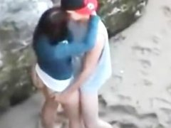 Girl pleases boyfriend on the beach