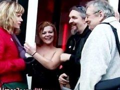 Amateur couple visit a big tits Dutch hooker for sex
