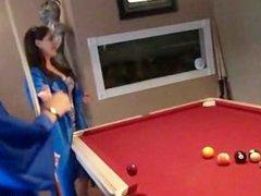 Drunk graduates playing pool
