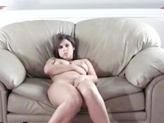 Busty brunette beauty plays with her wet pussy