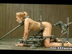 Immobilized on all four blonde babe gets machine fucked