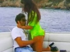 Brunette fucking her pussy in boat