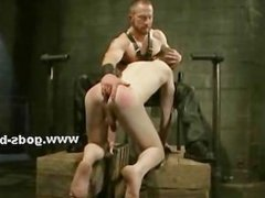 Muscular slave gets his throat brutally fucked by a dominating ma