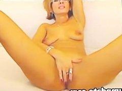 Horny MILF spreads her legs and masturbating