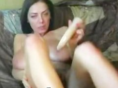 Babe with massive boobs dildoing her pussy