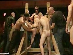 Hot stud tied up and fucked in front of 100 horny men