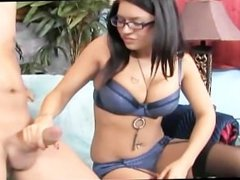 Brunette with big tits and glasses gives a handjob while wearing lingerie