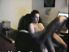 Ebony babe rides white cock on a chair